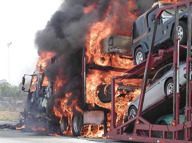 This isn't the kind of flame job we want.  Car hauler burning on interstate 15